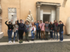 Students pose in front of the Colossus of Constantine Marble Hand in the courtyard of Palazzo dei Conservatori in Rome